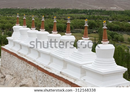 Buddhist chortens , stupa and Himalayas mountains in the background near Shey Palace in Ladakh, India