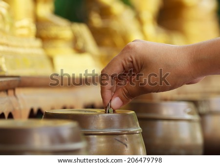 Buddhist donate money for Buddha - stock photo