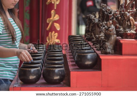 Buddhist is donating money to a Chinese temple by their faith and to maintain the temple. - stock photo
