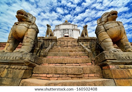 Buddhist lion statues protecting a temple in Bhaktapur, Nepal - stock photo