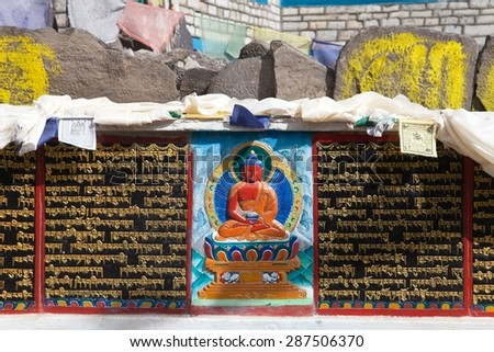 buddhist mani prayer wall on the way to Everest base camp with buddhist tibetan symbols and prayer flags, Khumbu valley, Sagarmatha national park, Nepal - stock photo