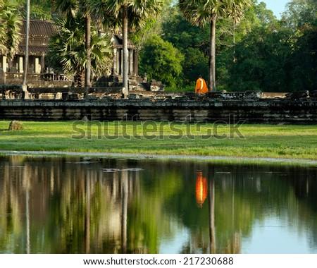 Buddhist monk at Angkor Thom temple. Angkor Wat complex, Siem Reap, Cambodia travel destinations - stock photo