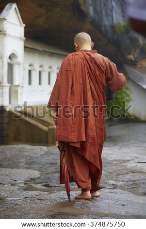 Buddhist Monk discovered a Temple - stock photo