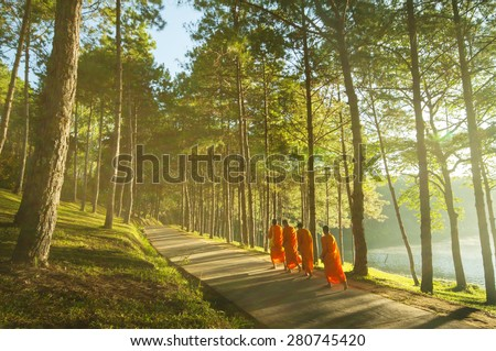 Buddhist Monk Walking for Receive Food at Pang Ung in Mae Hong Son-Thailand - stock photo