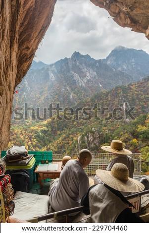 Buddhist monks at seorak mountains cave at the Seorak-san National Park, Soraksan, South korea - stock photo
