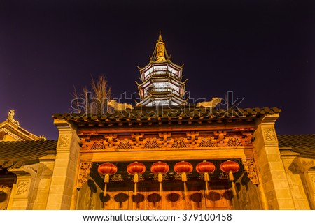 Buddhist Nanchang Nanchan Temple Wooden Door Pagoda Tower Wuxi Jiangsu Province, China.  Temple was established in approximately 550 AD. - stock photo