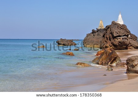 Buddhist pagodas on top of rocks found on the beach of Ngwe Saung, west coast of Myanmar - stock photo
