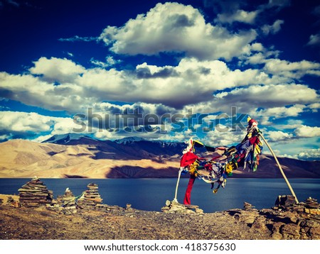 Buddhist prayer flags lungta at Himalayan lake Tso Moriri, Korzok, Ladakh, India - stock photo