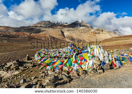 Buddhist prayer flags (lungta) on Baralacha La pass on Manali-Leh highway in Himalayas. Himachal Pradesh, India