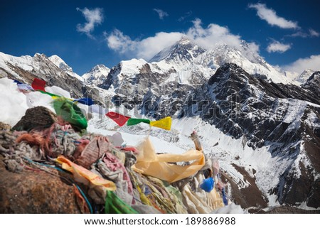 Buddhist prayer flags on top of Gokyo Ri (5,360 m.) and direct view of Everest - the world's highest mountain (8,848 m.). Himalayas, Solukhumbu District (Sagarmatha National Park), Nepal