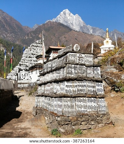 Buddhist prayer mani walls, way to Everest base camp, way from Lukla to Namche Bazar, Nepal - stock photo