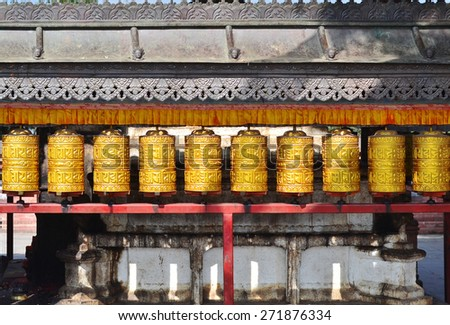 Buddhist prayer wheels in  Boudhanath,Kathmandu capital of Nepal - stock photo