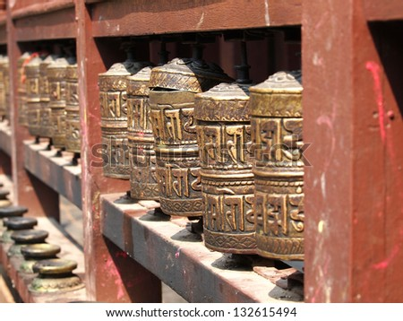 Buddhist prayer wheels, pathan,golden temple Nepal - stock photo