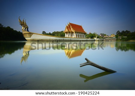 buddhist shrine in Suphannahong ship on the pond at wat Ban Na Muang, Ubon Ratchathani province, Thailand - stock photo