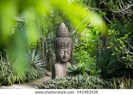Buddhist statue in a garden in Thailand - travel and tourism image.
