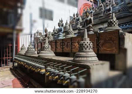 Buddhist statue in Gangaramaya Temle. Sri Lanka - stock photo