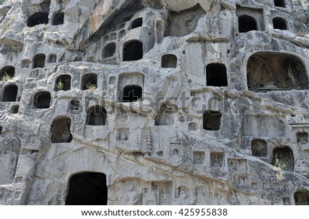 Buddhist stone carvings and caves within longmen grottoes in Luoyang China in henan province.