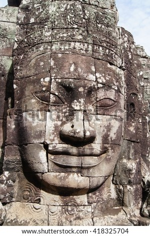 Buddhist stone face at Bayon Temple in the Angkor Wat temple complex near Siem Reap in Cambodia. - stock photo