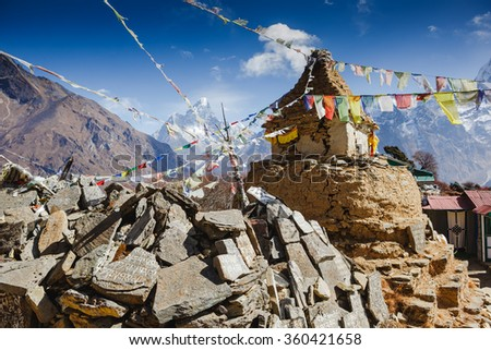 Buddhist stupa and prayer flags in the Himalaya mountains, Everest region, Nepal - stock photo