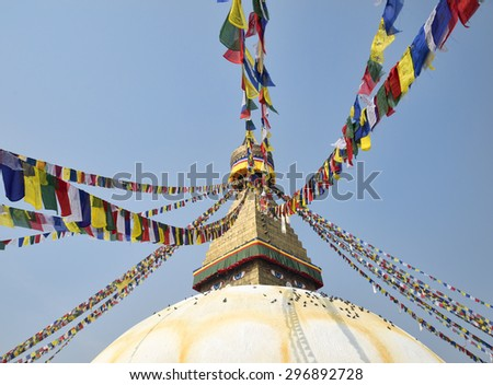 Buddhist stupa Boudnath and colorful prayer flags