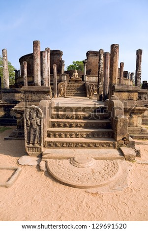 Buddhist stupa in Pollonnaruwa. Polonnaruwa was the second capital of Sri Lanka after the destruction of Anuradhapura in 993. It comprises the monumental ruins created in the 12th century. - stock photo