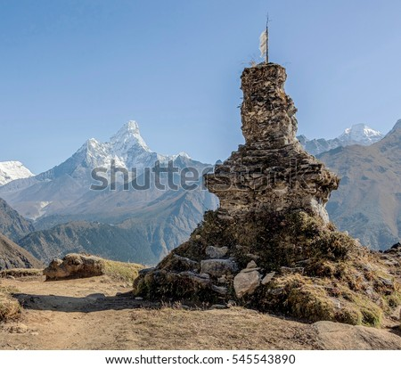 Buddhist stupa on the background of the Ama Dablam (6814 m) on a sunny day - Nepal, Himalayas