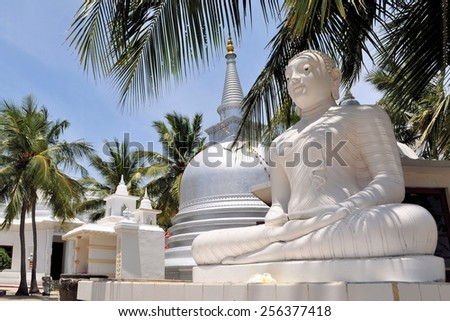 Buddhist Stupa under palm trees on Nainativu island near Jaffna in Indian Ocean, Sri Lanka, erected by Sri Lankan army after capitulation of Tamil Tigers - stock photo