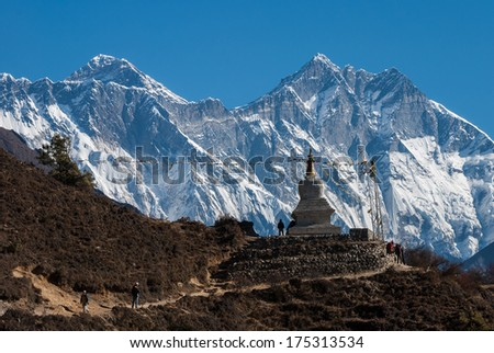 Buddhist stupa with Lhotse wall and Mt. Everest in background, Nepal - stock photo