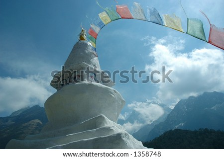 Buddhist stupa with prayer flags along the trail to Dingboche (Pangboche) village, Mt Everest Trek