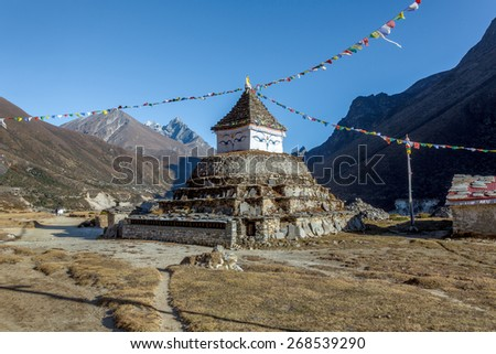 Buddhist stupa with ritual flags - Everest region, Nepal, Himalayas - stock photo
