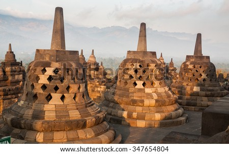 Buddhist stupas at Borobudur temple complex in Yogyakarta, Java, Indonesia. - stock photo