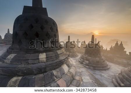 Buddhist Temple Borobudur Taken at Sunrise. Yogyakarta, Indonesia  - stock photo