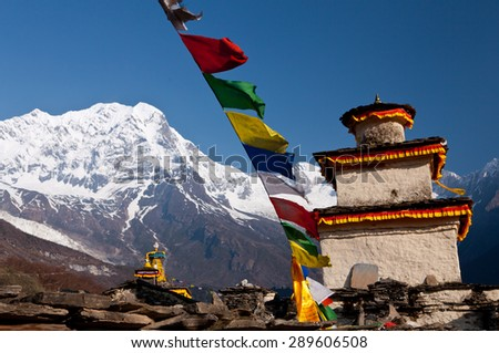 Buddhist temple in mountains - Nepal - stock photo