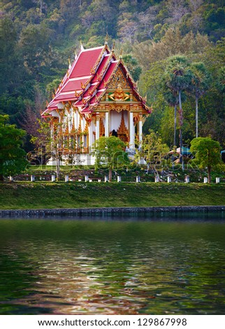 Buddhist temple on the bank of pond - Thailand.