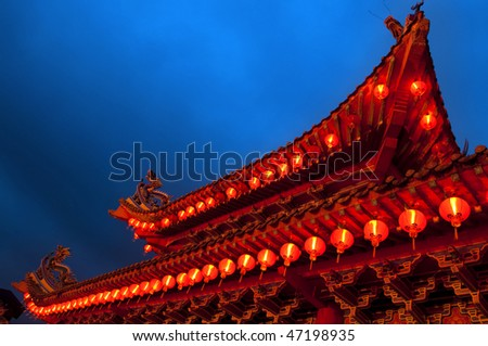 Buddhist temple. Red Chinese lanterns display, taken at the Chinese New Year celebrations. Red is lucky colour for Chinese. - stock photo