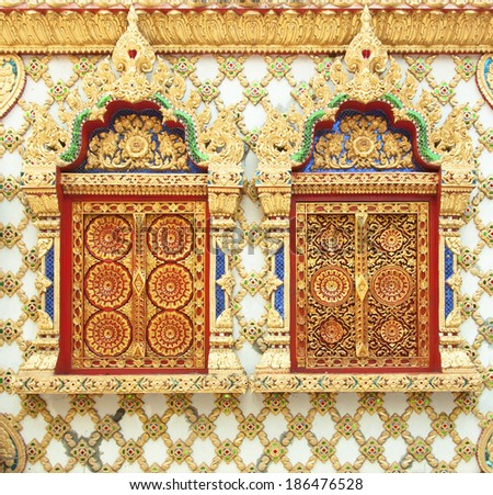Buddhist temple wall in Thailand traditional pattern. - stock photo