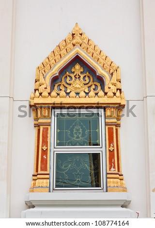 Buddhist temple window sculpture - stock photo