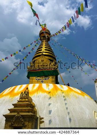 Buddhist temple with flags, buddhist stupa with eyes in Nepal, Sagarmatha stupa in Kathmandu, white buddhist stupa, asian religion buddhism temple, buddha eyes on white stupa, buddhist temple in Nepal - stock photo