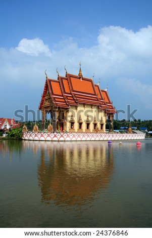 buddhist temple with moat samui thailand