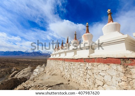Buddhist white stupa and blue sky in the background in Shey Palace in Leh , Ladakh, India - stock photo