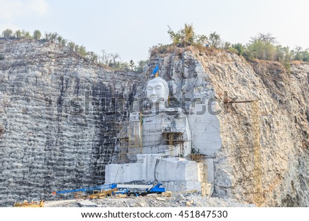 Buddhists in Thailand are carved marble mountain is shaped like the Buddha meditating, Wat Kaotumteam, U Thong, Suphanburi - stock photo