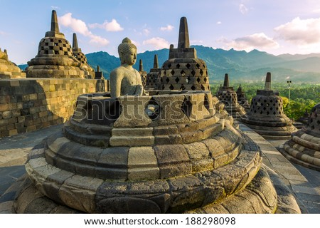 Buddist temple Borobudur at  sunset. Yogyakarta. Java, Indonesia  - stock photo