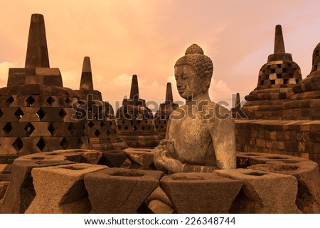 Buddist temple Borobudur on sunset background. Yogyakarta. Java, Indonesia - stock photo