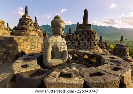 Buddist temple Borobudur on sunset background. Yogyakarta. Java, Indonesia