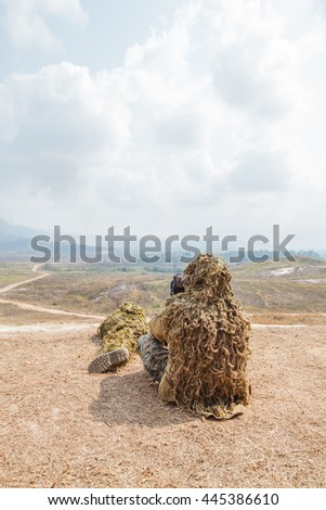 Buddy snipers tell distance and wind speed. - stock photo