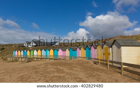 Bude North Cornwall England uk with colourful pastel beach huts on the beach on a beautiful day