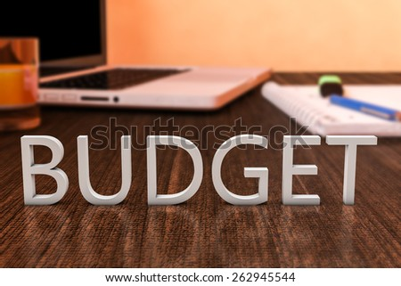 Budget - letters on wooden desk with laptop computer and a notebook. 3d render illustration. - stock photo