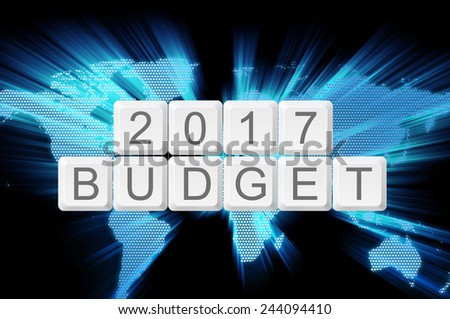 Budget 2017 0n keyboard button with shiny zoom world map. - stock photo
