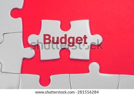 Budget on white puzzle - Business Concept - stock photo