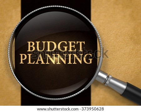 Budget Planning Concept through Magnifier on Old Paper with Black Vertical Line Background. 3d Render. - stock photo